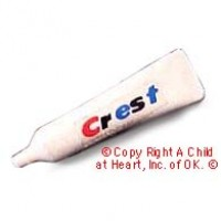 § Disc .80¢ Off - Dollhouse Crest Tooth Paste (Tube) - Product Image